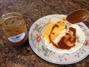 Eggs with enchilada sauce